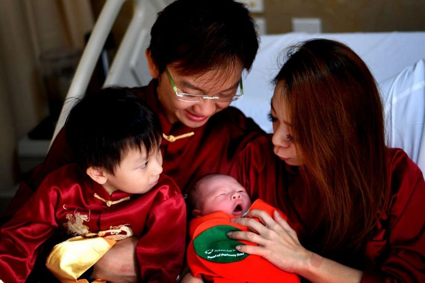 (Clockwise from left) Ayden Seanady Wong, Sean Christopher Wong, Adelyne Velvet Fung and newborn Ayvius Seanady Wong at Parkway East Hospital on Jan 28.