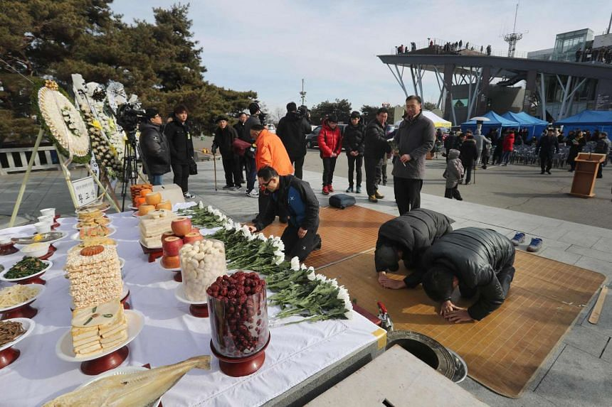 Visitors bowing in front of an altar at the Imjingak Peace Park in Paju, near the Demilitarized Zone separating North and South Korea.