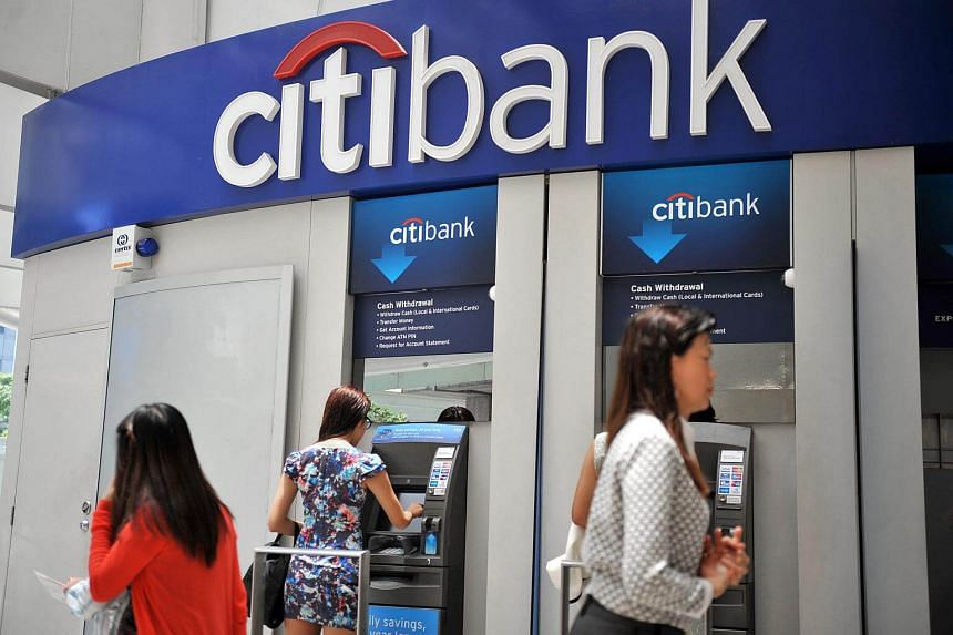 Office workers using the Citibank ATM services at Raffles Place.