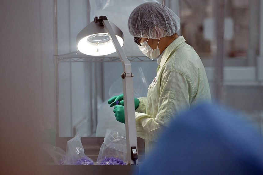 A worker in a medical clean room environment at Univac Precision Engineering at its manufacturing plant in Woodlands.