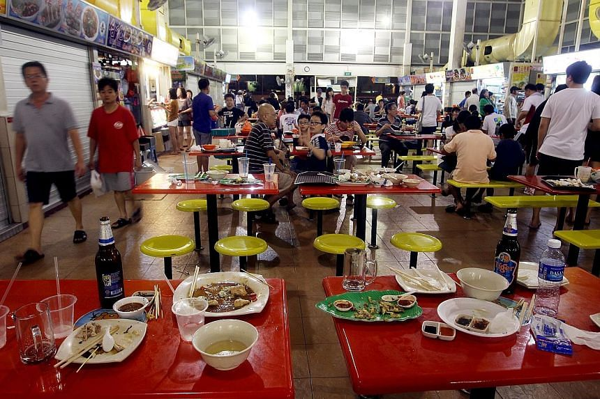 Dirty plates and cutlery left at tables are a common sight at many food centres here. The writer says automation could help to improve cleanliness.