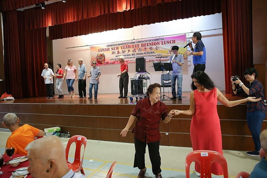 Mrs Kavita dancing with a beneficiary at the Chinese New Year reunion lunch event organised by Henderson-Dawson CCC yesterday.