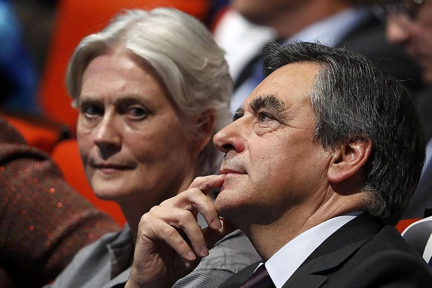 French presidential candidate Francois Fillon with his wife, Penelope. The father of five has run his campaign on an image of Christian values, but he is facing blowback over claims that Mrs Fillon took public money without cause.