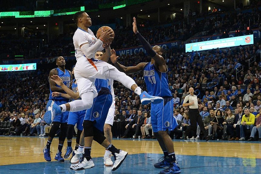 Oklahoma City Thunder Russell Westbrook driving to the basket as Dallas Mavericks forward Harrison Barnes (No. 40) attempts to stop him. The Thunder point guard, who had 45 points on the night, was named in the Western Conference team's reserves rost
