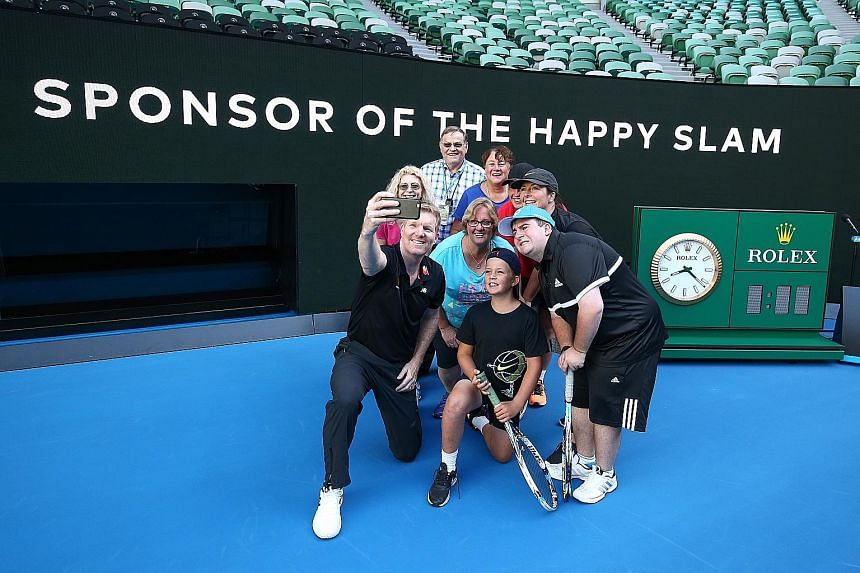 Former world No. 1 Jim Courier, a Mastercard ambassador, taking a wefie with fans at Rod Laver Arena. He also played tennis with cardholders on centre court during the Australian Open.