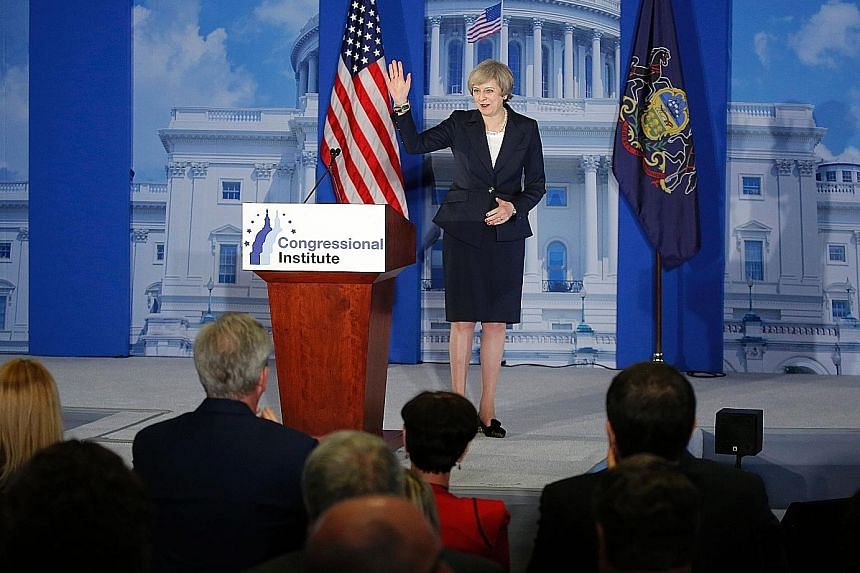 In her speech at the retreat for members of the Republican Party in Philadelphia on Thursday, Mrs May signalled a shift in foreign policy, bringing her position more in line with that of Mr Trump.