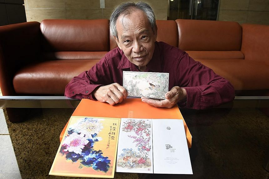 Mr Lee with the hongbao featuring his artwork, as well as the card with Mr Tan's work (left) and the hongbao with Mr Koh's painting.