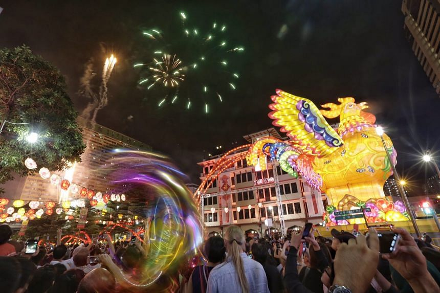 Fire crackers and fireworks set off at he stroke of midnight during the Chinatown Chinese New Year 2017 Countdown Party on Jan 27, 2017.