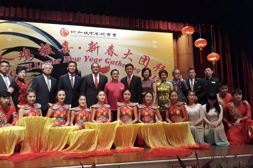 SCCCI President Mr Thomas Chua (standing, third from left), Minister for Education (Higher Education and Skills) Ong Ye Kung (standing, fourth from left), Minister for Trade and Industry (Industry) S. Iswaran (standing, fifth from left) and Labour ch
