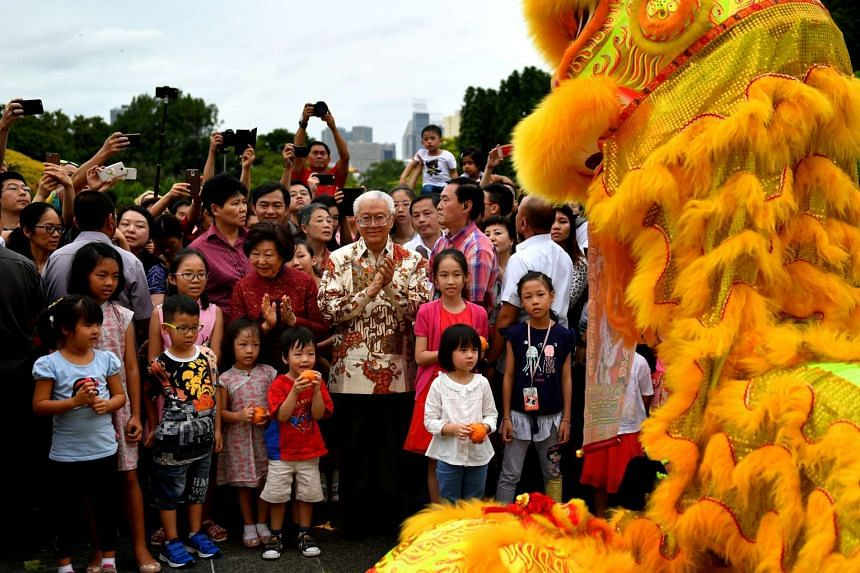 President Tony Tan watches a lion dance performance at the Istana grounds on the second day of Chinese New Year (Jan 29).
