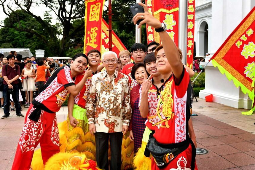 President Tony Tan and Mrs Mary Tan take a wefie with lion dance performers at the Istana grounds on the second day of Chinese New Year (Jan 29).