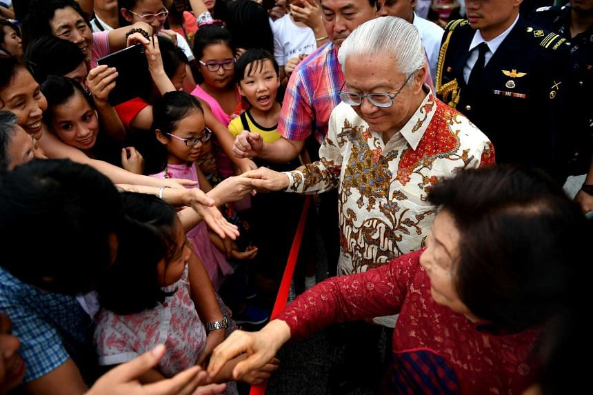 President Tony Tan and Mrs Mary Tan shake hands with visitors at the Istana grounds on the second day of Chinese New Year (Jan 29).