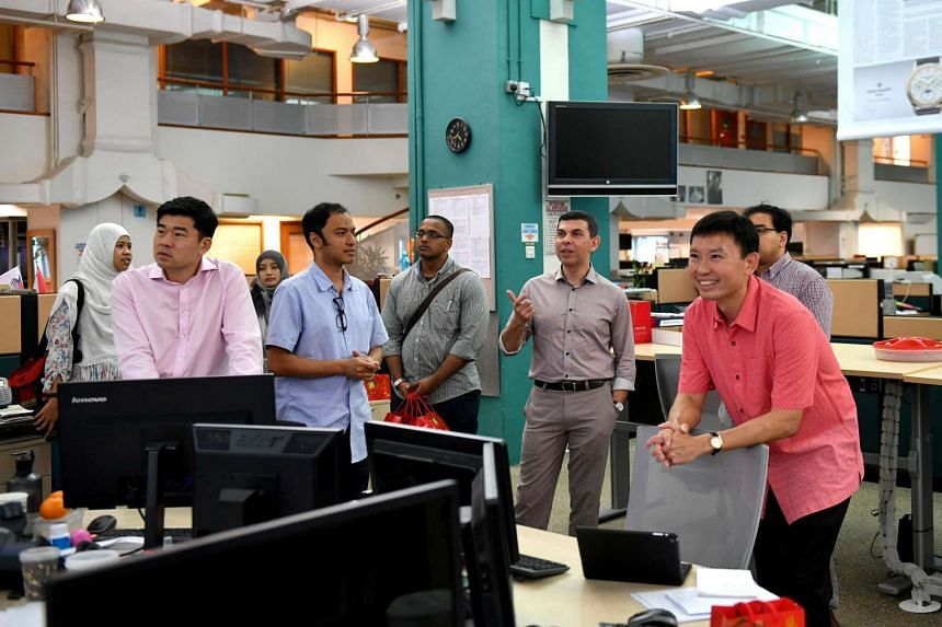 Minister of State Chee Hong Tat (extreme right) at the Straits Times newsroom on the first day of Chinese New Year on Jan 28, 2017. Also on the visit was Permanent Secretary for Communications and Information Gabriel Lim (second from left). He was br