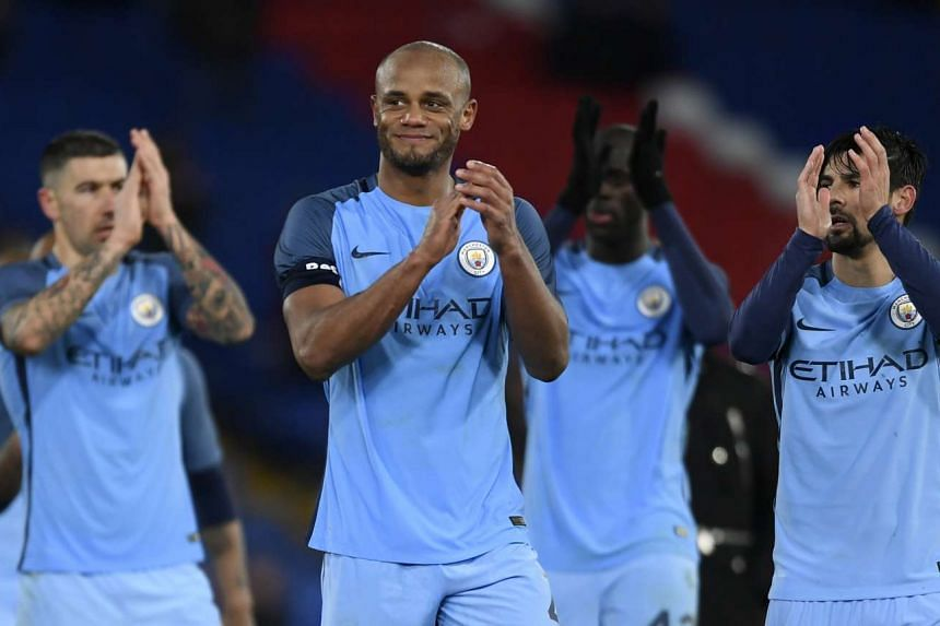 Manchester City's Vincent Kompany applauds fans after the game.