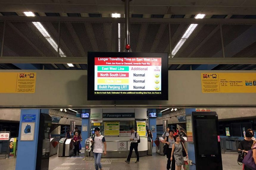 A sign at Queenstown MRT station advising passengers of a 10-minute delay on the East-West line on Jan 23, 2017.