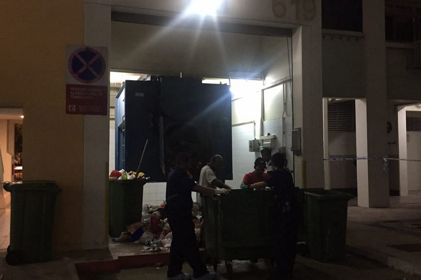 Police looking through the rubbish collection point.