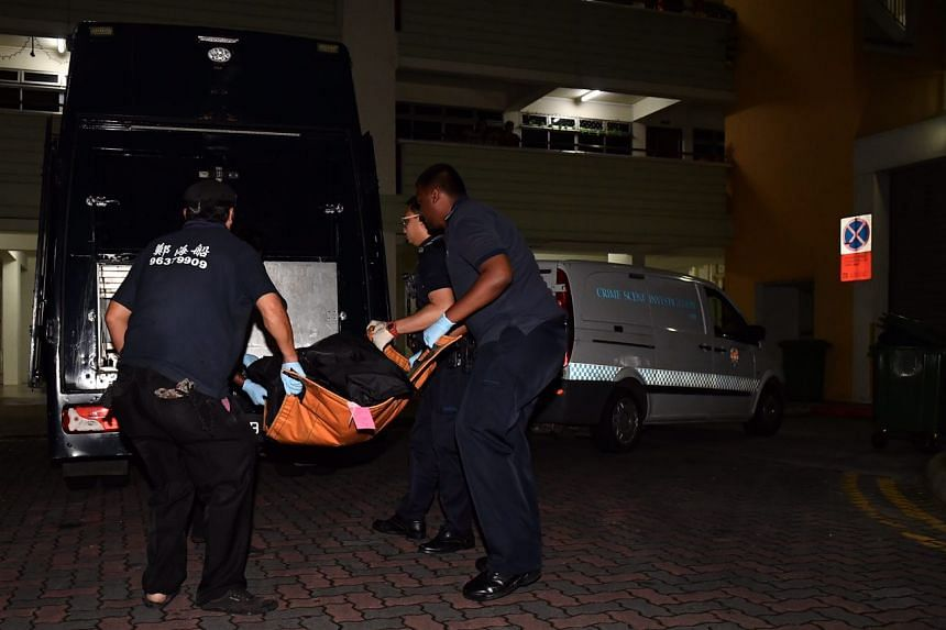The victims' bodies being removed from the scene.