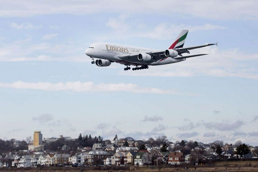 An Emirates Airbus A380 plane prepares to land at Logan International Airport (BOS) in Boston, Massachusetts,  on Jan 6, 2017.