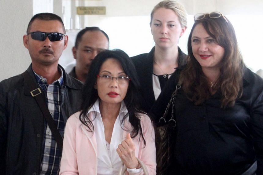 Former Malaysian beauty queen Pauline Chai (pictured, centre) said that divorce proceedings in Malaysia could be considered redundant.