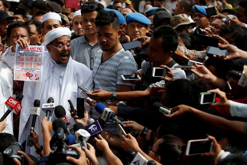 The leader of the hardline Islamic Defenders Front, Habib Rizieq, speaks to journalists at police headquarters following his questioning by police in Jakarta, Indonesia on Jan 23, 2017.