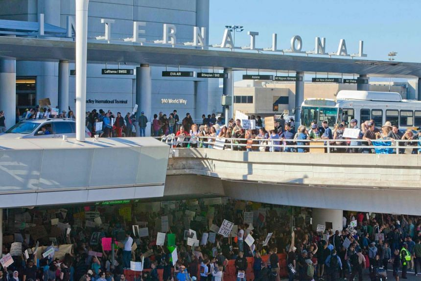 Protesters gather at the Los Angeles International airport's Tom Bradley terminal to demonstrate against President Donald Trump's travel ban.