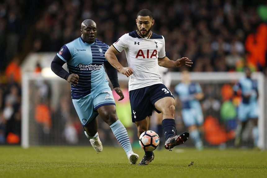 Tottenham's Cameron Carter-Vickers in action with Wycombe Wanderers' Adebayo Akinfenwa during the football match between Tottenham Hotspur and Wycombe Wanderers, on Jan 28, 2017.
