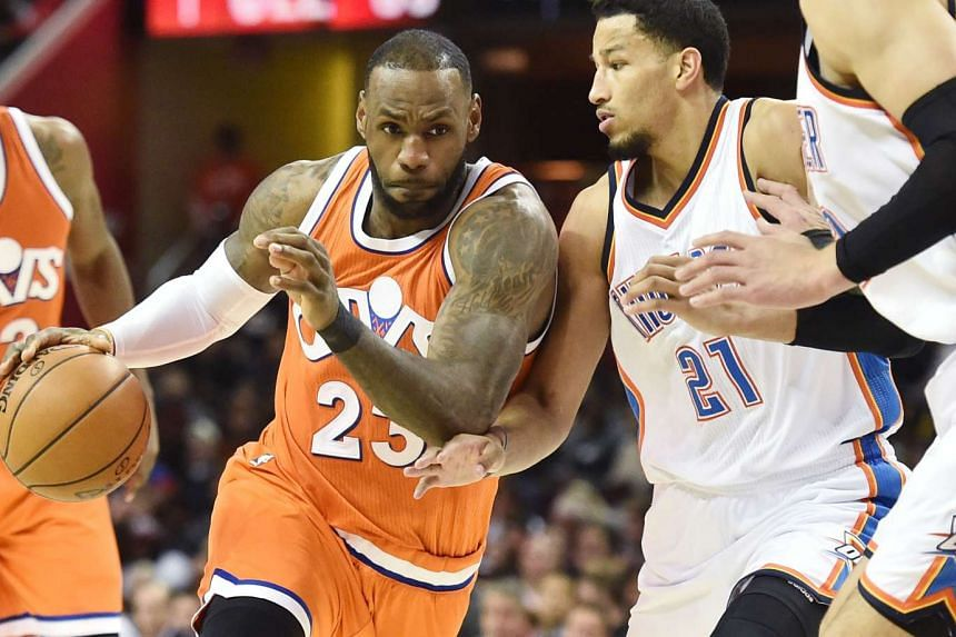 Cleveland Cavaliers forward LeBron James (#23) driving to the basket against Oklahoma City Thunder forward Andre Roberson (#21) during their NBA match on Jan 29, 2017.