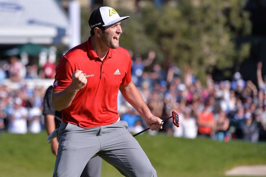 Golfer Jon Rahm celebrating after an eagle on the 18th hole during the Farmers Insurance Open golf tournament on Jan 29, 2017.