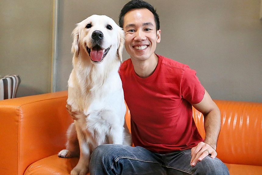 Mr Ethan Loke with his golden retriever Boo. He did not have a dog when he was growing up as his parents did not allow it.