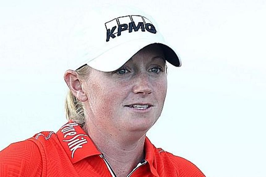 Stacy Lewis (above) had two eagles and seven birdies to put her level with Lexi Thompson at 23-under total of 196 after three rounds of the LPGA Pure Silk Bahamas Classic.