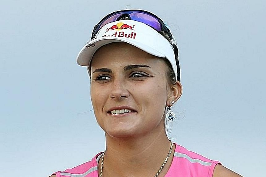 Stacy Lewis had two eagles and seven birdies to put her level with Lexi Thompson (above) at 23-under total of 196 after three rounds of the LPGA Pure Silk Bahamas Classic.