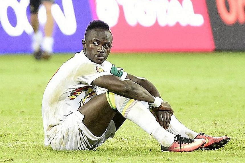 Senegal forward Sadio Mane is distraught after his penalty miss. Senegal's loss will be Liverpool's gain as Mane is now expected to play some part in the crucial Premier League clash against Chelsea