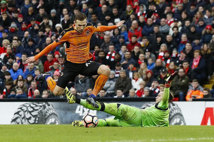 Wolves forward Andreas Weimann scores the winner against Liverpool in the FA Cup. The under-fire Reds will be hoping to get their season back on track with a positive result against Premier League leaders Chelsea.
