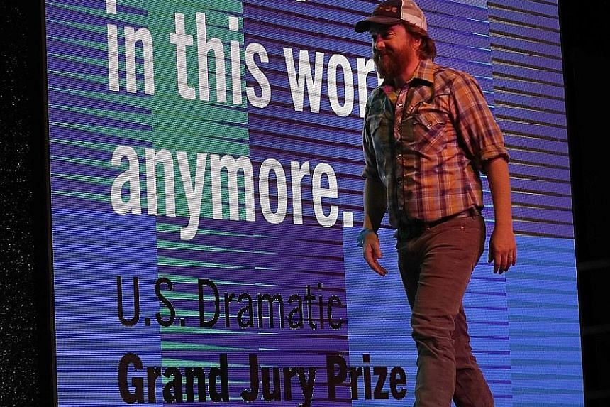 US director Macon Blair wins the US Dramatic Grand Jury Prize for his film, I Don't Feel At Home In This World Anymore.