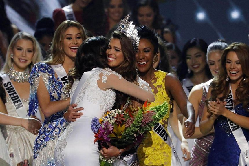 Contestants congratulating Miss France Iris Mittenaere after she was declared winner in the Miss Universe beauty pageant, on Jan 30, 2017.
