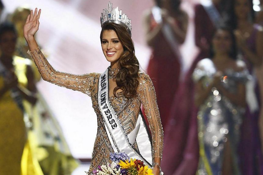 Iris Mittenaere from France waving after being named the 65th Miss Universe during the coronation ceremony of the Miss Universe pageant, on Jan 30,  2017.