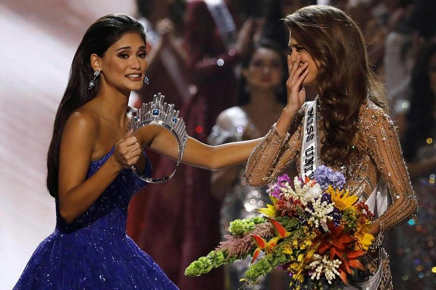 Pia Wurtzbach walking towards Miss France Iris Mittenaere after the latter was declared winner in the Miss Universe beauty pageant, on Jan 30, 2017.