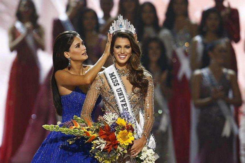 Iris Mittenaere (right) from France is crowned the 65th Miss Universe by her predecessor, Pia Alonzo Wurtzbach (left) from the Philippines during the coronation night of the Miss Universe pageant, on Jan 30, 2017.