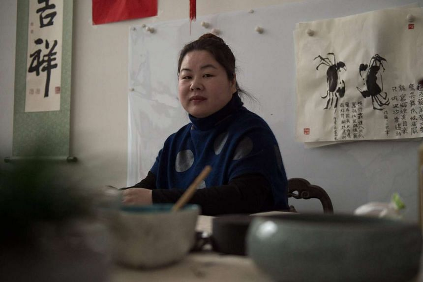 Ye Haiyan in her unheated apartment on the outskirts of Beijing.