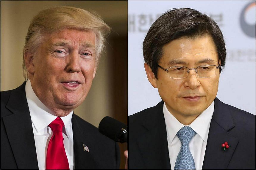 US President Donald Trump (left) and South Korean Acting President Hwang Kyo Ahn agreed to take steps to strengthen joint defence capabilities to defend against threats from North Korea.