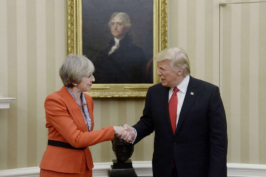 US President Donald Trump, right, shakes hands with Theresa May, British prime minister, in the Oval Office of the White House in Washington, D.C. on Jan 27.
