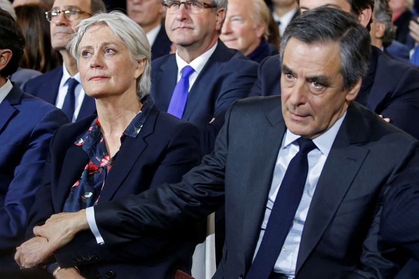 Mr Francois Fillon and his wife Penelope attending a political rally in Paris on Jan 29, 2017.