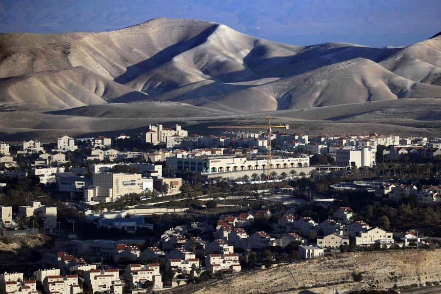 The Israeli Knesset has postponed a vote that would allow Israel to appropriate Palestinian land in the West Bank.