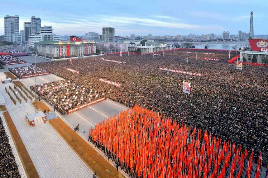 A mass rally taking place at Kim Il Sung Square in Pyongyang.