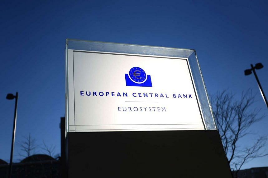 A euro currency symbol sits on a Eurosystem sign outside the European Central Bank (ECB) headquarters in Frankfurt, Germany.