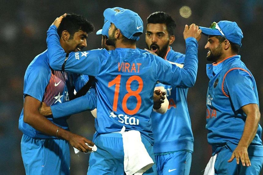 India's Jasprit Bumrah (left) celebrating with teammates after winning the second T20 cricket match between India and England at the Vidarbha Cricket Association's Jamtha stadium in Nagpur, on Jan 29, 2017.