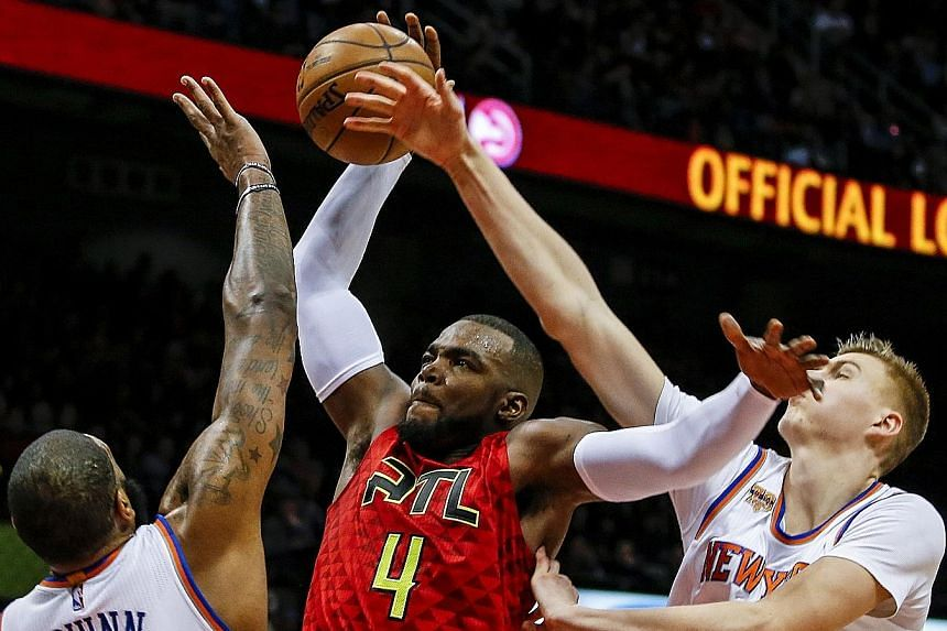 Paul Millsap (in red) put the Hawks ahead with 27 seconds remaining and finished with season-high 37 points.