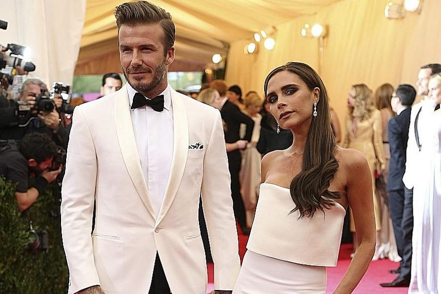 """David Beckham with his wife, Victoria. The former England soccer captain has rejected suggestions the couple is staying together for the Beckham """"brand""""."""
