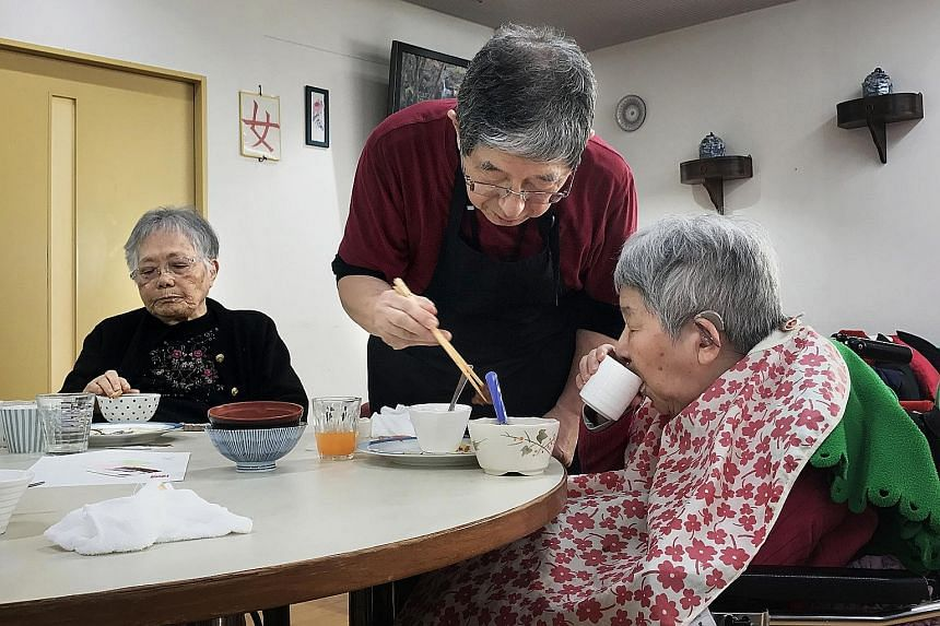 Mr Kunio Odaira (centre), 72, is a caregiver at the Cross Heart rest home in Yokohama, Japan. More than half of the staff there are over 60 years old.