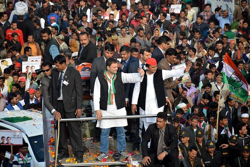 Congress party vice-president Rahul Gandhi (centre left) and Samajwadi Party president Akhilesh Yadav (centre right) in Lucknow on Sunday.